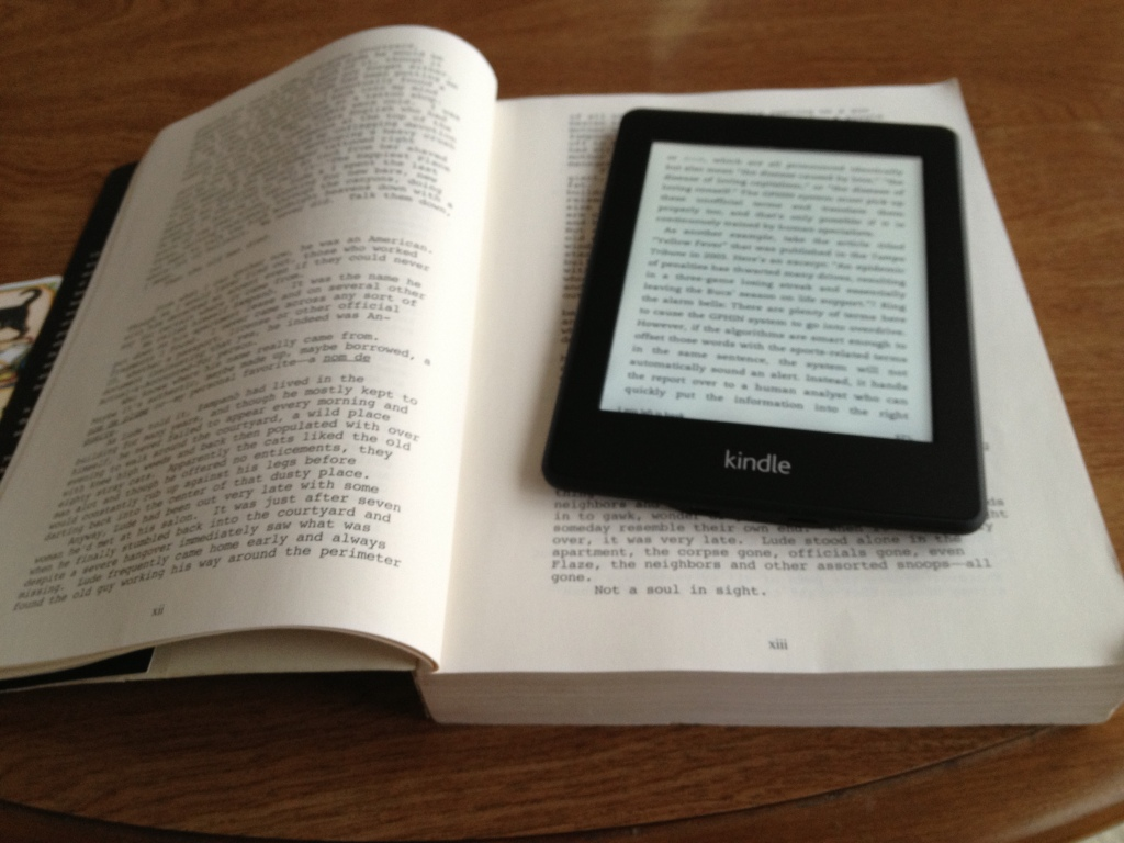 Kindle on top of real book