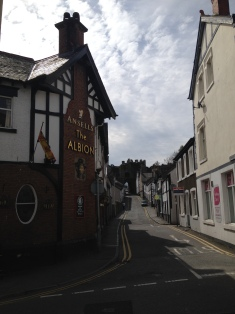 Walking uphill through Conwy, past the Albion
