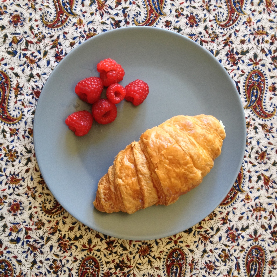 Croissant and berries — a mid-morning snack
