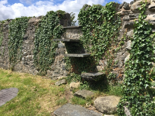 The stile over the church wall (used by mourners during funerals)